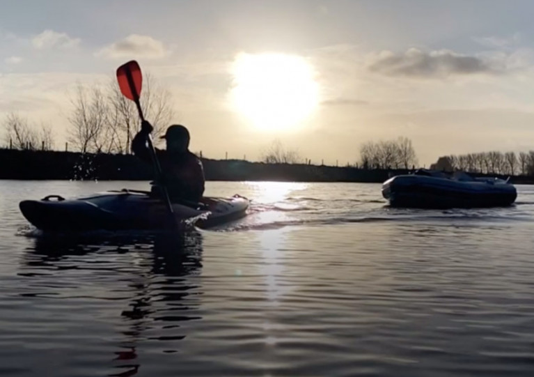 Kayaker John Medlow and his dinghy on the River Bann