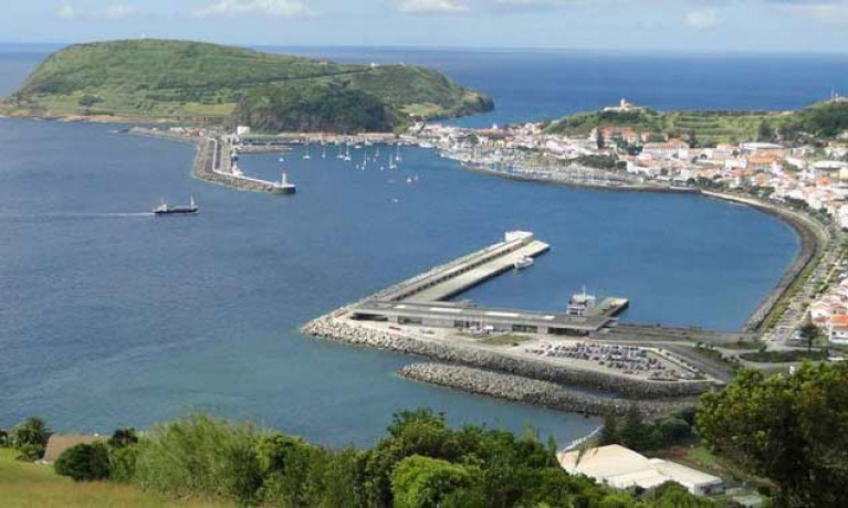 Friendly port and ocean crossroads – Horta in the Azores, with the commercial, ferry and cruise-liner berths in foreground, while the anchorage, old harbour, and yacht harbour are beyond