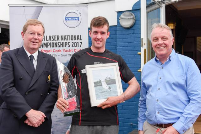 Overall winner in the Laser Standard Finn Lynch (centre) is presented with his prize by (left) John Roche Admiral Royal Cork and sponsors Mark Whitaker of Volvo. Scroll down for photo gallery of prizewinners